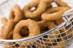 Onion-Ring-Day-Church Breaded onion rings in a basket. ©bigstockphoto.com/monkeybusinessimages