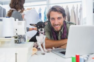 Take-Your-Dog-Work-Day-Church Fashion designer with his chihuahua at work. ©bigstockphoto.com/Wavebreak Media Ltd