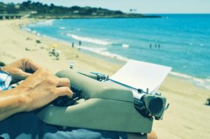 Typewriter-Day-Church A young man typing in an old typewriter at the beach. ©bigstockphoto.com/nito