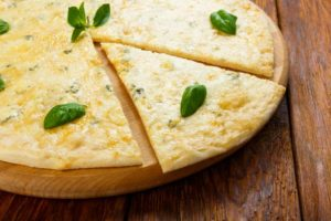 cheese-pizza-day-church Cheese pizza may be one of the simplest kinds of pizza, but it is no less delicious. ©bigstockphoto.com/Milkos